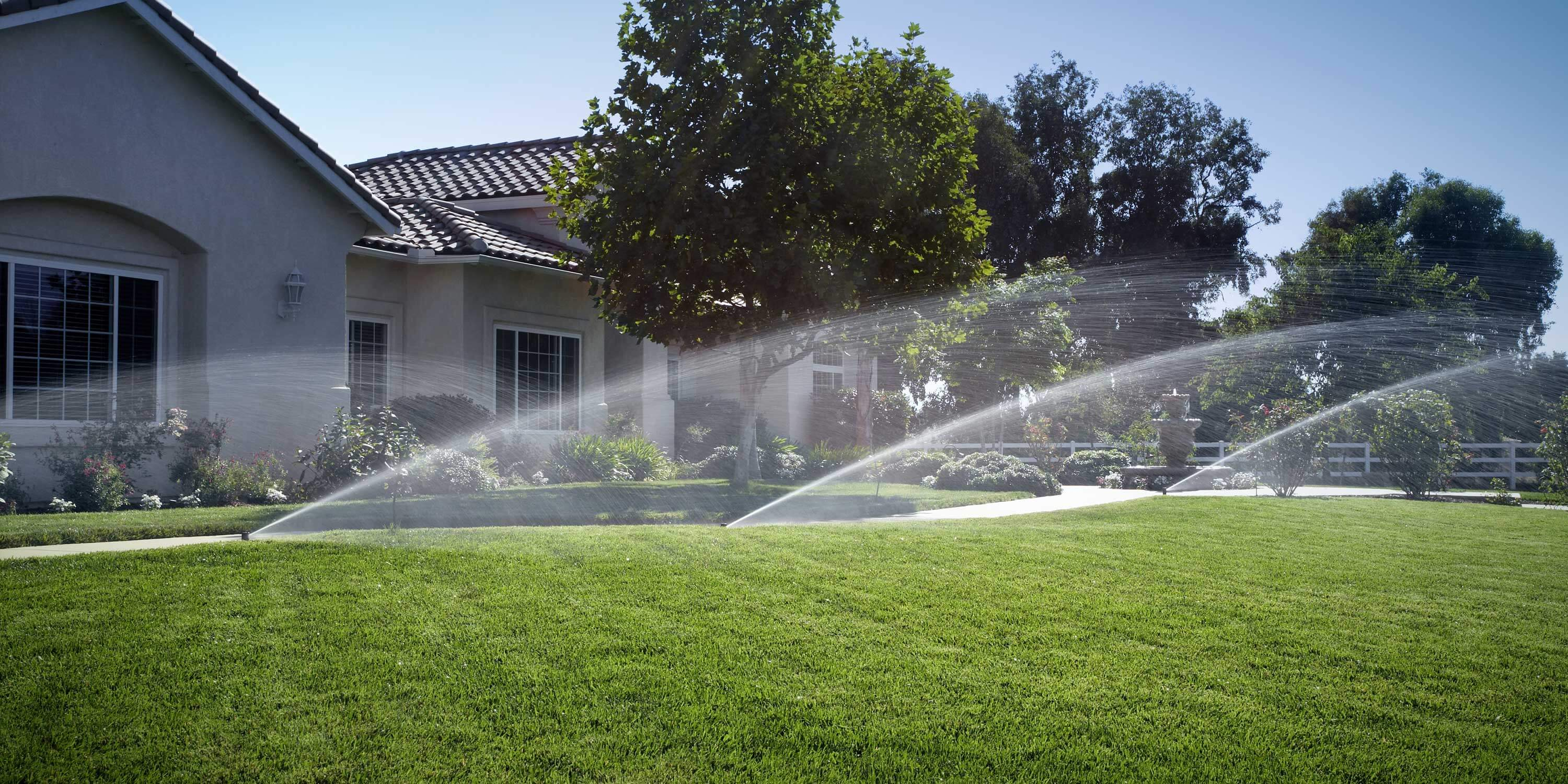 sprinklers in front of a house